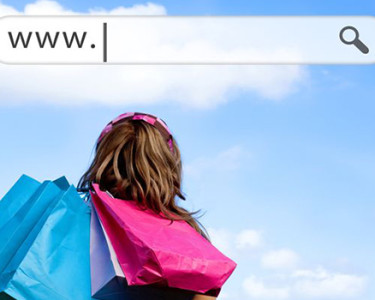 Girl holding shopping bags with address bar above against a blue sky