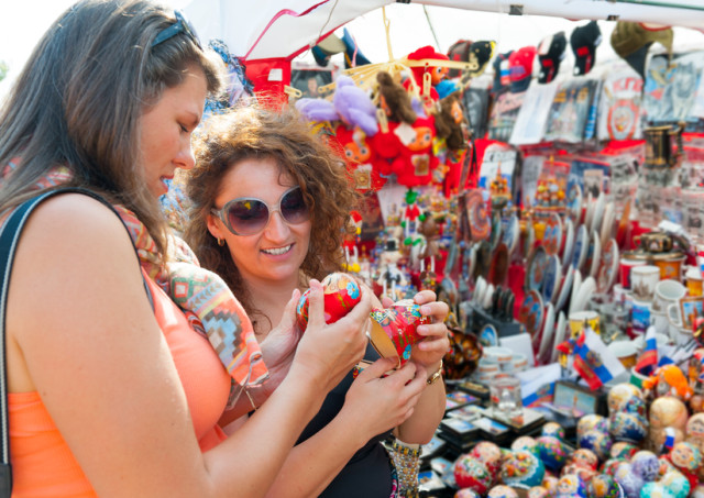 Female tourists choosing souvenirs in the store