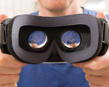 Man using virtual reality headset at home